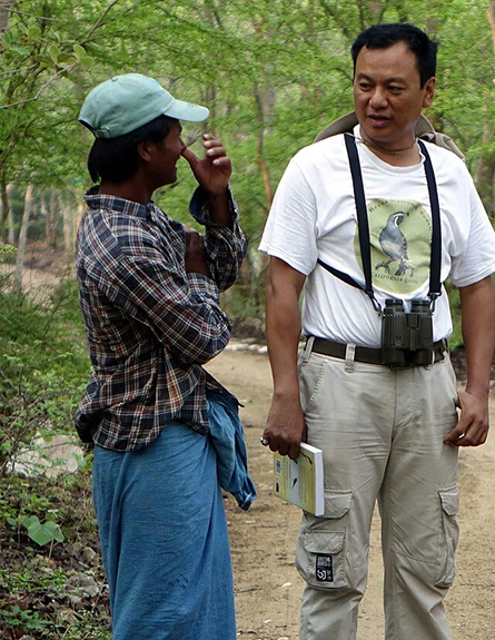 Aung Myo Chit in discussion with a villager in Tawyagyi Wildlife Sanctuary